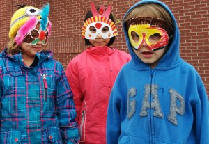 close up of kids with masks