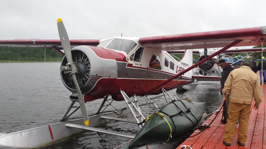 Figure 1 Beaver float plane prepares for takeoff with first canoe and team members