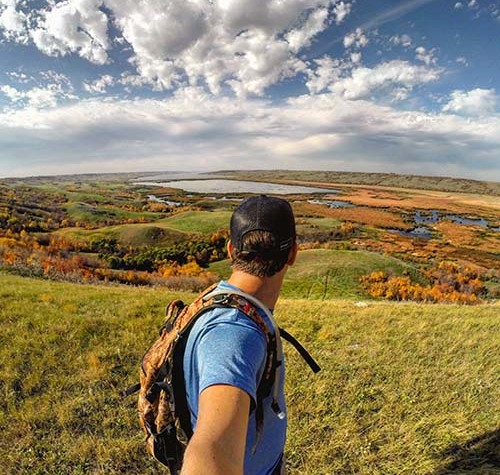Image of a man hiking in Saskatchewan in the fall