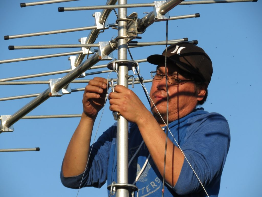 Image of a man installing a tower