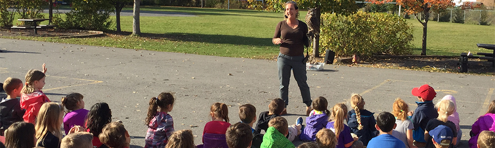 School kids get up close and personal with birds of prey