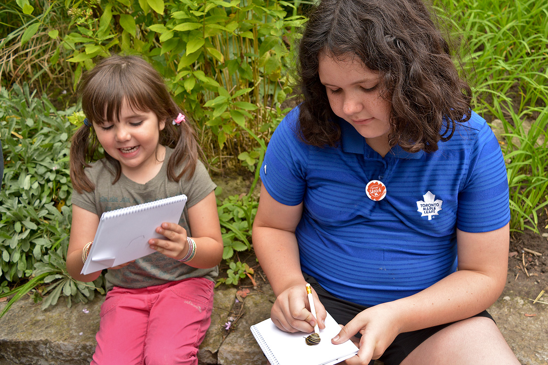 Image of two girls participating in Nature Sketch